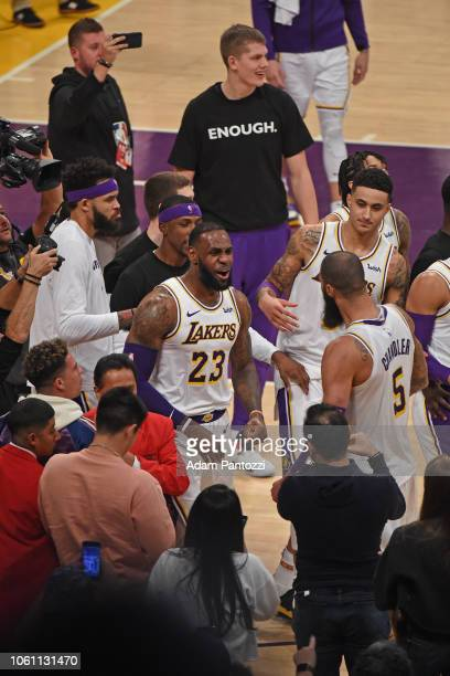 LeBron James and Tyson Chandler of the Los Angeles Lakers celebrate the game winning block against the Atlanta Hawks on November 11 2018 at Staples...