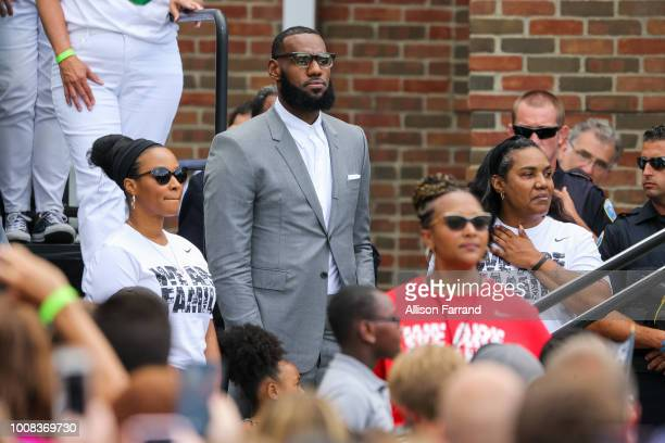 LeBron James arrives with his wife Savannah James and Gloria James for the grand opening of the I Promise school on July 30 2018 in Akron Ohio The...