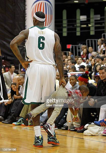 LeBron James carries his son Bryce James during the South Florida All Star Classic at Florida International University on October 8 2011 in Miami...