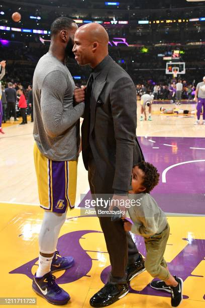 LeBron James catches up with his exteammate Richard Jefferson during halftime of a basketball game between the Los Angeles Lakers and the Brooklyn...