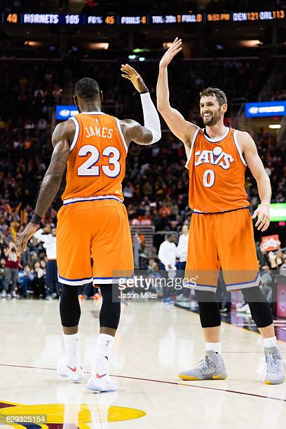 LeBron James celebrates with Kevin Love of the Cleveland Cavaliers after James scored during the second half against the Charlotte Hornets at Quicken...