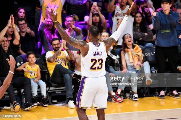 LeBron James celebrates with the fans during a basketball game between the Los Angeles Lakers and the Charlotte Hornets at Staples Center on October...