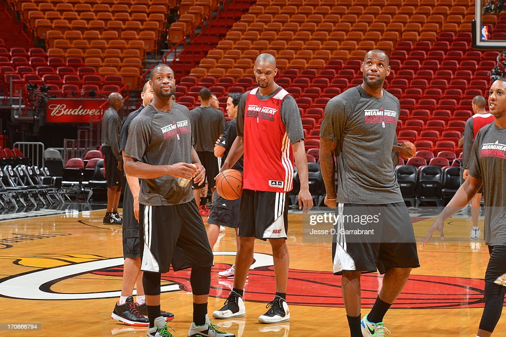 LeBron James, Chris Bosh and Dwyane Wade of the Miami Heat warm up at practice as part of the 2013 NBA Finals on June 19, 2013 at American Airlines Arena in Miami, Florida.