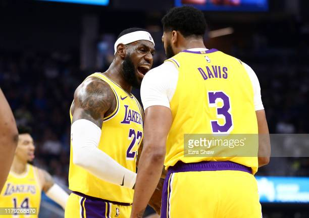 LeBron James congratulates Anthony Davis of the Los Angeles Lakers after he made a basket against the Golden State Warriors at Chase Center on...