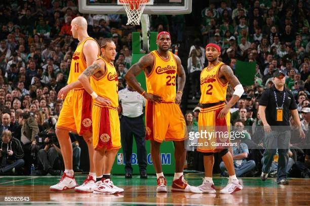 LeBron James Delonte West and Mo Williams of the Cleveland Cavaliers talk during a break against the Boston Celtics during the game on March 6 2009...