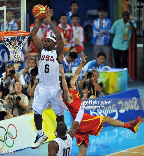 US LeBron James dunks during the men's preliminary round group B basketball match USA vs China at the Olympic basketball gymnasium during the 2008...