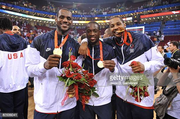 LeBron James Dwyane Wade and Carmelo Anthony of the US Men's Senior National Team celebrates winning the men's gold medal basketball game at the 2008...