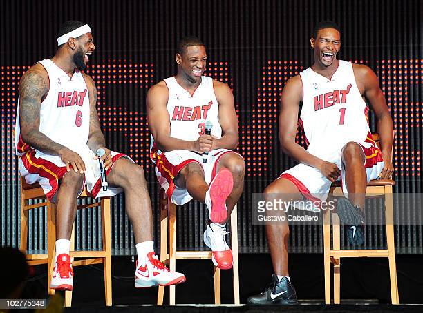 LeBron James Dwyane Wade and Chris Bosh of the Miami Heat speak after being introduced to fans during a welcome party at American Airlines Arena on...