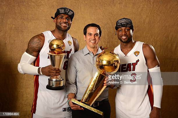 LeBron James, Head Coach Erik Spoelstra and Dwyane Wade of the Miami Heat poses for a portrait with the Larry O'Brien Trophy after defeating the San...