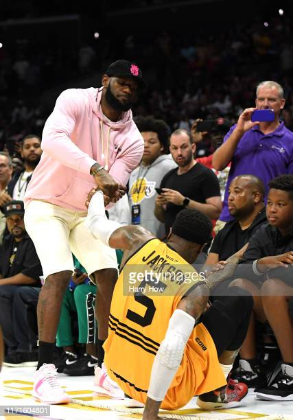 LeBron James helps up Stephen Jackson of Killer 3s during the BIG3 Championship at Staples Center on September 01, 2019 in Los Angeles, California.
