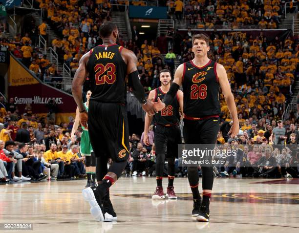 LeBron James high fives Kyle Korver of the Cleveland Cavaliers against the Boston Celtics in Game Three of the Eastern Conference Finals of the 2018...