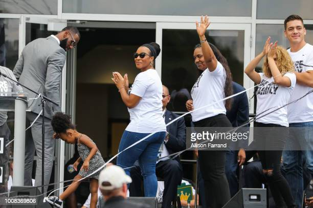 LeBron James his daughter Zhuri his wife Savannah his mother Gloria and singer Tori Kelly leave the stage after the grand opening of the I Promise...