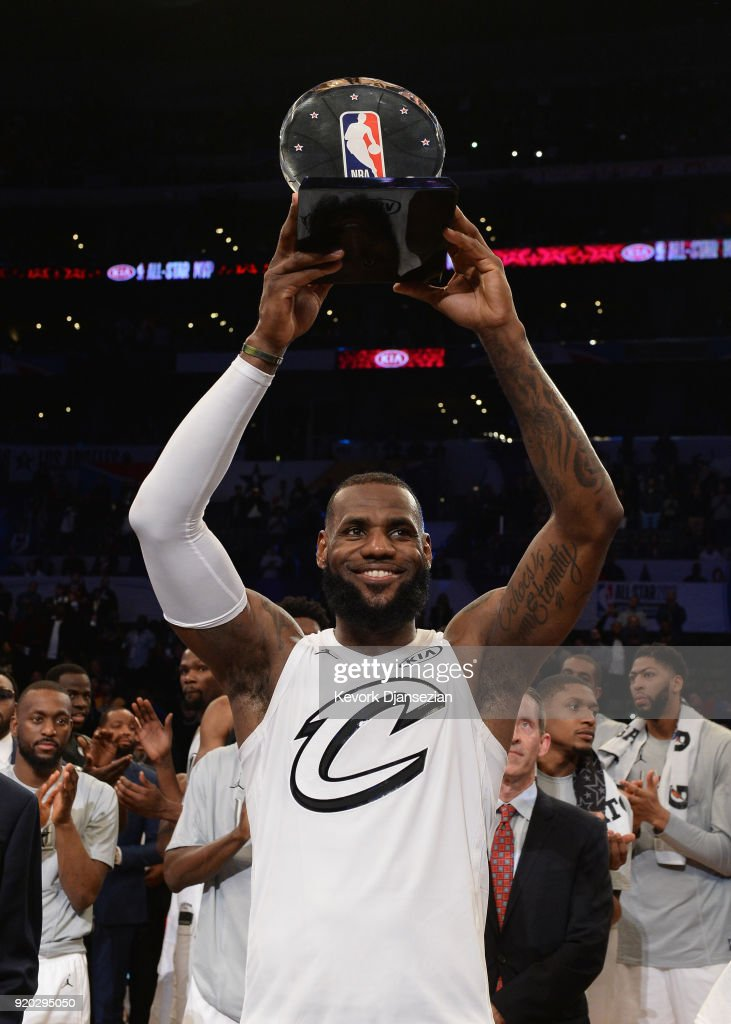 LeBron James #23 hoists the All-Star Game MVP trophy during the NBA All-Star Game 2018 at Staples Center on February 18, 2018 in Los Angeles, California.
