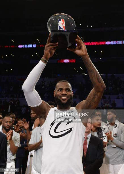 LeBron James hoists the AllStar Game MVP trophy during the NBA AllStar Game 2018 at Staples Center on February 18 2018 in Los Angeles California