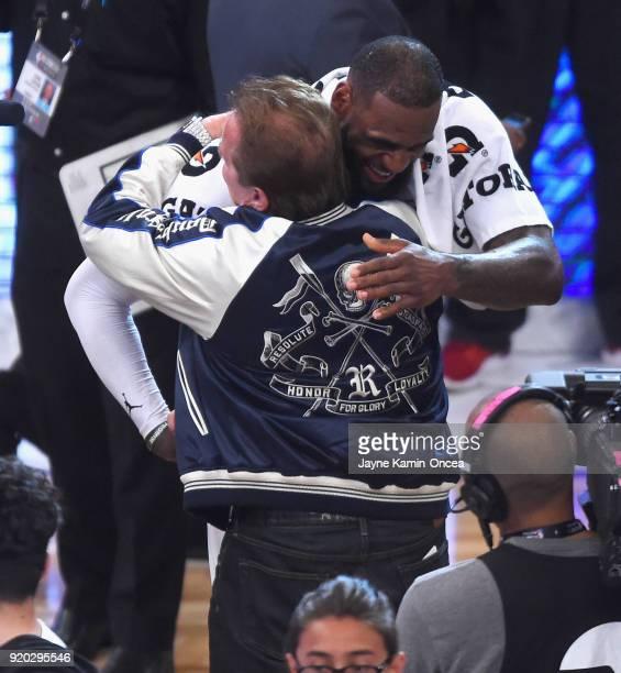 LeBron James hugs Arnold Schwarzenegger during the NBA AllStar Game 2018 at Staples Center on February 18 2018 in Los Angeles California