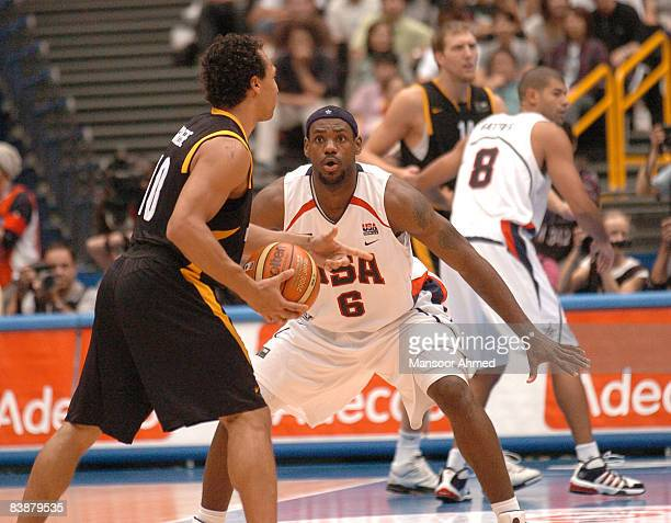 Lebron James is all about focus as he defends Demond Greene of Germany during the FIBA World Championship 2006 quarterfinal game between the United...