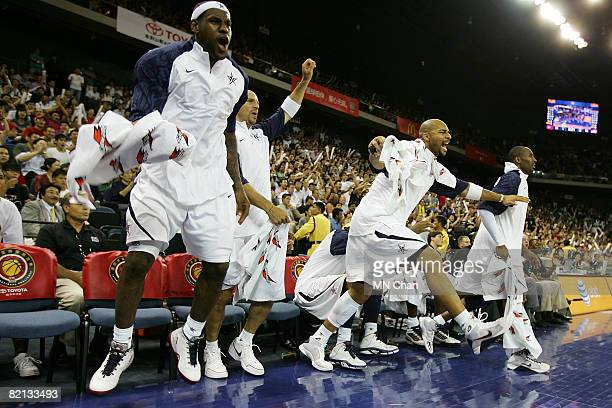LeBron James, Jason Kidd, Carlos Boozer and Kobe Bryant of USA Basketball Men's Senior National Team celebrate a goal scored against the Turkey...