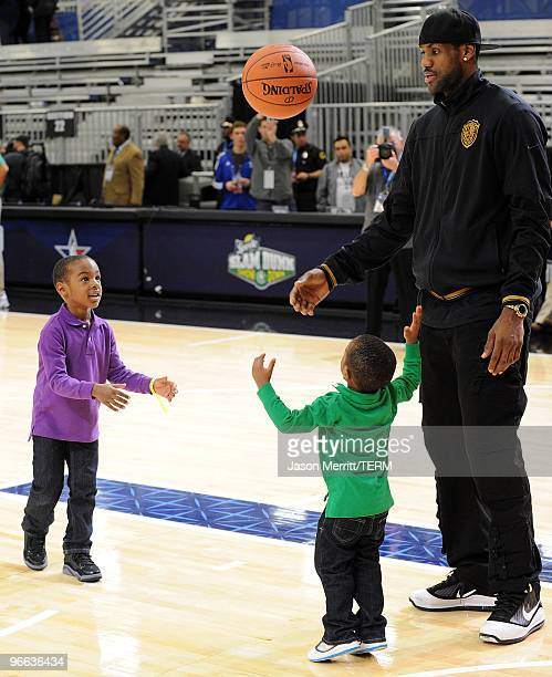 LeBron James Jr Bryce James and NBA player LeBron James shoot the ball during the NBA AllStar celebrity game presented by Final Fantasy XIII held at...