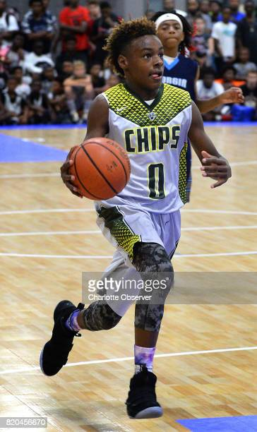 LeBron James Jr drives to the basket during youth tournament action at the Charlotte Convention Center in Charlotte NC on Friday July 21 2017
