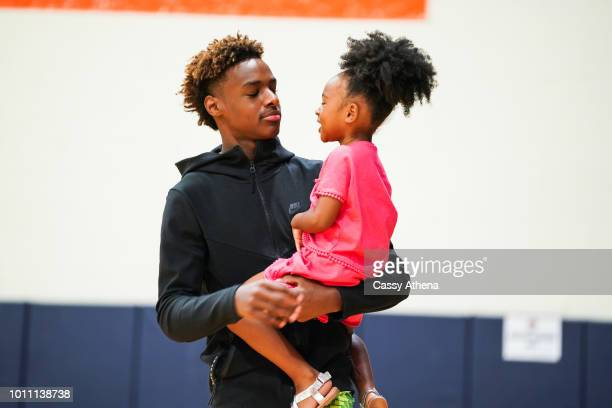 LeBron James Jr holds his sister Zhuri James at Zaire Wade's AAU game at the Fab 48 tournament at Bishop Gorman High School on July 26 2018 in Las...