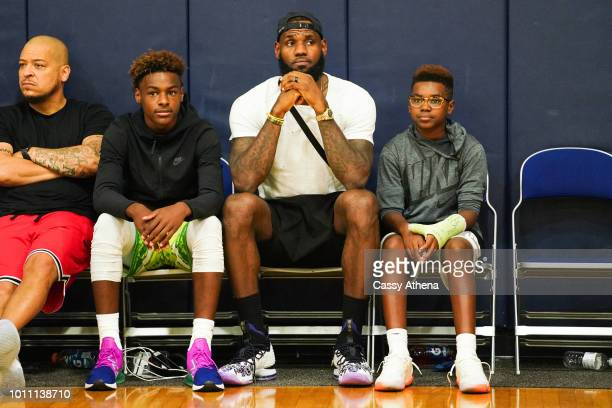 LeBron James Jr LeBron James Sr and Bryce Maximus James watch Zaire Wade's AAU game court side at the Fab 48 tournament at Bishop Gorman High School...