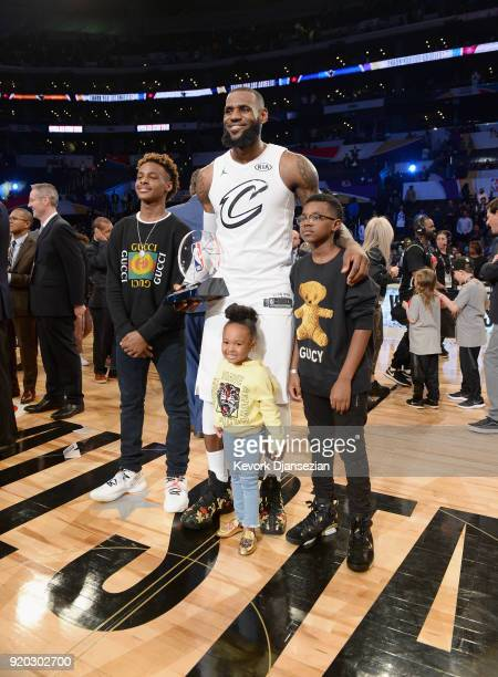 LeBron James Jr LeBron James Zhuri James and Bryce Maximus James pose for a photo with the AllStar Game MVP trophy during the NBA AllStar Game 2018...