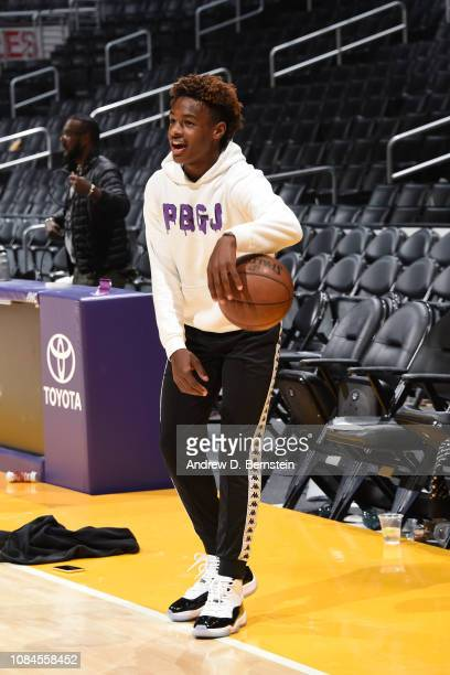 LeBron James Jr smiles and dribbles the ball on the court before the LA Clippers game against the Los Angeles Lakers on December 28 2018 at STAPLES...