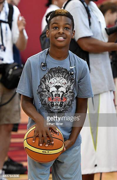 LeBron James Jr son of LeBron James of the 2015 USA Basketball Men's National Team shoots during a practice session at the Mendenhall Center on...