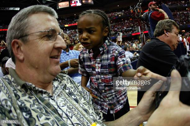 LeBron James Jr son of LeBron James of the Cleveland Cavaliers looks at a picture of his father on the back of David Heritsch's digital camera as the...