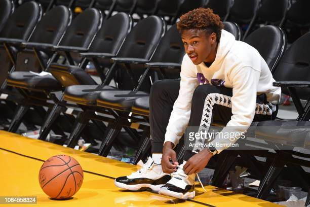 LeBron James Jr ties his sneakers on the court before the LA Clippers game against the Los Angeles Lakers on December 28 2018 at STAPLES Center in...