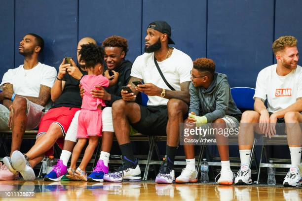LeBron James Jr Zhuri James LeBron James Sr and Bryce Maximus James watch Zaire Wade's AAU game court side at the Fab 48 tournament at Bishop Gorman...