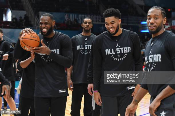LeBron James KarlAnthony Towns and Kawhi Leonard of Team LeBron smile and laugh during the 2019 NBA AllStar Practice and Media Availability on...