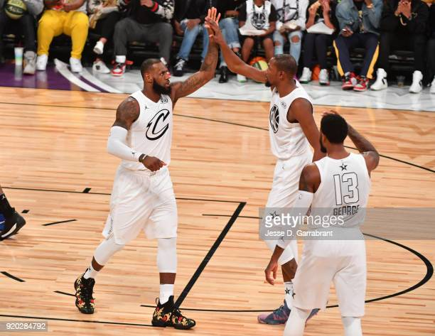 LeBron James Kevin Durant and Paul George of Team LeBron give each other high fives against Team Curry during the NBA AllStar Game as a part of 2018...
