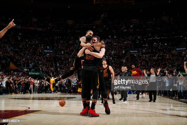 LeBron James Kevin Love Kyle Korver George Hill of the Cleveland Cavaliers react after game winning shot against the Toronto Raptors during Game...