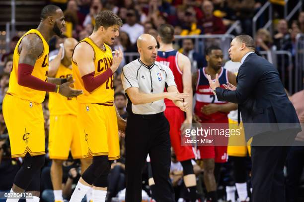 LeBron James Kyle Korver and head coach Tyronn Lue of the Cleveland Cavaliers all yell at referee Aaron Smith after Smith called a foul against the...