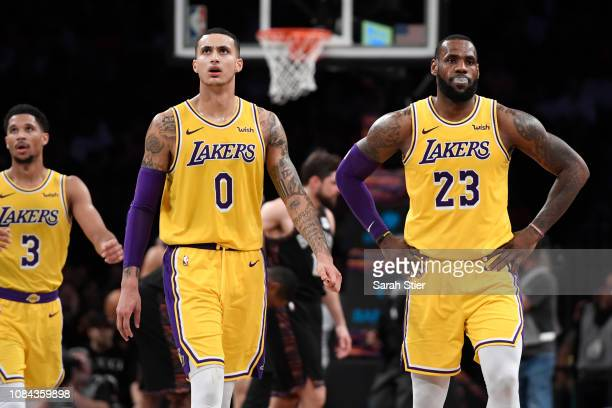 LeBron James Kyle Kuzma and Josh Hart of the Los Angeles Lakers react during a timeout in the fourth quarter of the game against the Los Angeles...