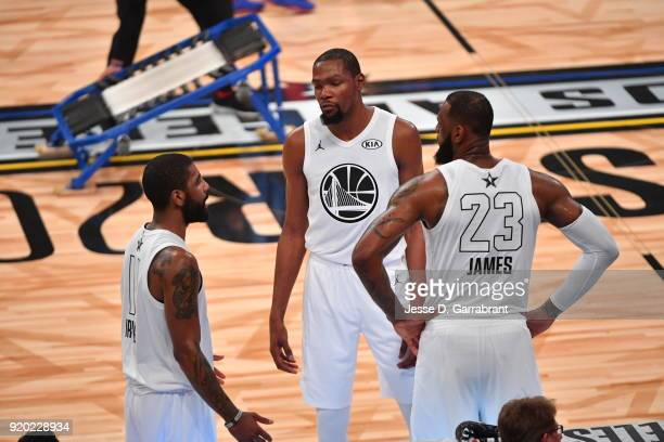 LeBron James Kyrie Irving and Kevin Durant of Team LeBron all look on against Team Curry during the NBA AllStar Game as a part of 2018 NBA AllStar...
