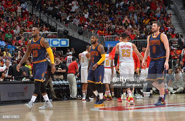 Lebron James Kyrie Irving and Kevin Love of the Cleveland Cavaliers look on against the Atlanta Hawks during the Eastern Conference Semifinals Game...