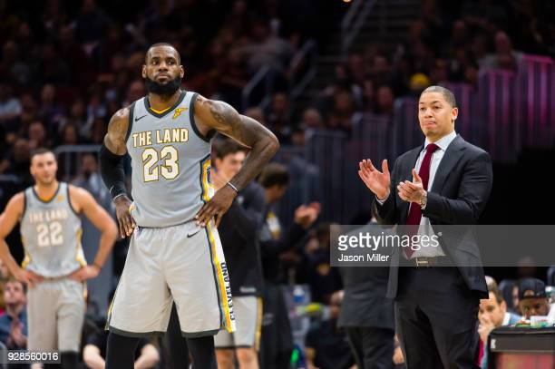 LeBron James listens to head coach Tyronn Lue of the Cleveland Cavaliers against the Denver Nuggets during the second half at Quicken Loans Arena on...