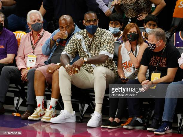 Lebron James looks on during the first half in Game Five of the NBA Finals between the Milwaukee Bucks and the Phoenix Sunsat Footprint Center on...