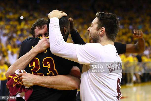 LeBron James Matthew Dellavedova and Kevin Love of the Cleveland Cavaliers celebrate after defeating the Golden State Warriors 9389 in Game 7 of the...