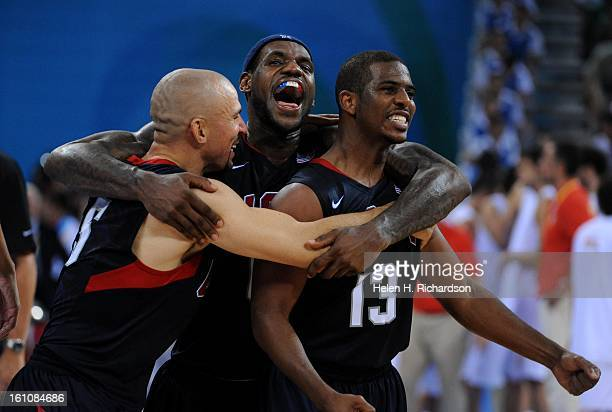Lebron James middle screams with joy while hugging teammates Jason Kidd left and Chris Paul right after the team's relatively narrow win over Spain...