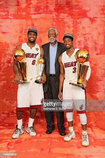 LeBron James, NBA Legend Bill Russell and Dwyane Wade of the Miami Heat poses for a portrait with both Larry O'Brien Trophies and Finals MVP Trophy...