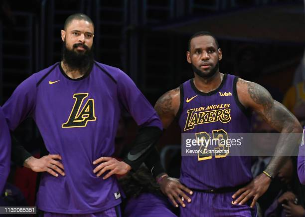 LeBron James of and Tyson Chandler of the Los Angeles Lakers follow the game from the bench at the end of the basketball game against Brooklyn Nets...
