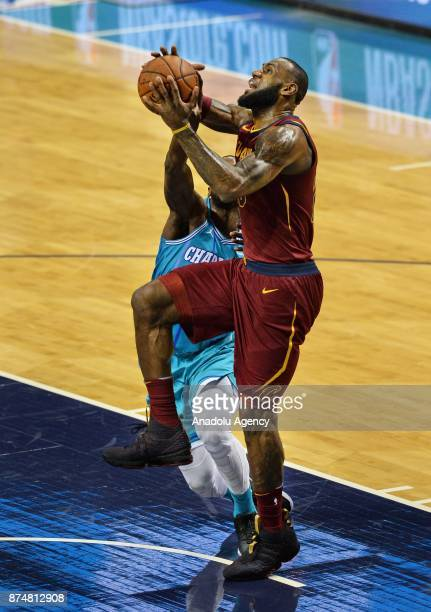 LeBron James of Cleveland Cavaliers jumps to score during the NBA match between Cleveland Cavaliers vs Charlotte Hornets at the Spectrum arena in...