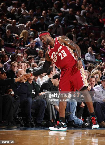 LeBron James of Cleveland Cavaliers says hello to recording artist Jay-Z during games against the New York Knicks on November 6, 2009 at Madison...