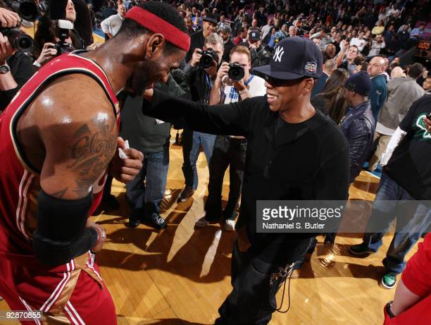 LeBron James of Cleveland Cavaliers shares a laugh with recording artist Jay-Z during games against the New York Knicks on November 6, 2009 at...
