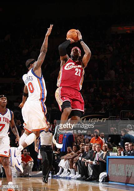 LeBron James of Cleveland Cavaliers shoots against Larry Hughes of the New York Knicks on November 6, 2009 at Madison Square Garden in New York City....