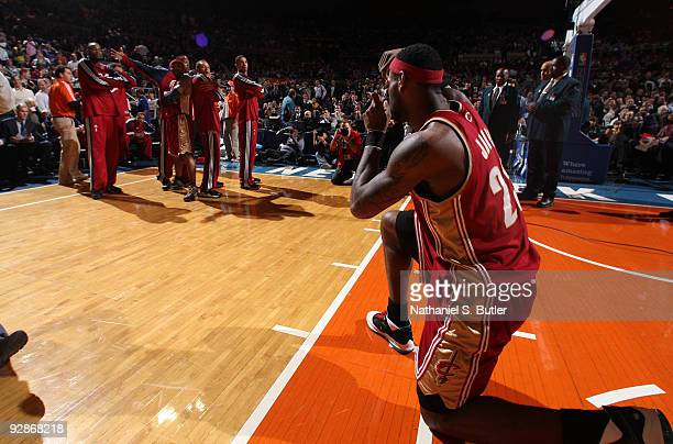 """LeBron James of Cleveland Cavaliers shoots his """"photo"""" of his teammates before game against the New York Knicks on November 6, 2009 at Madison Square..."""