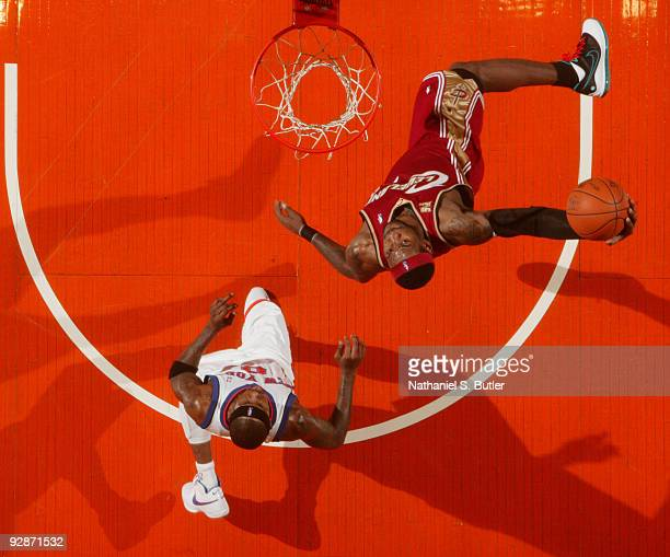 LeBron James of Cleveland Cavaliers the shoots against Larry Hughes of the New York Knicks on November 6, 2009 at Madison Square Garden in New York...
